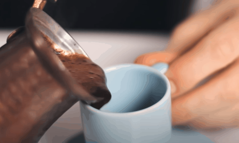 Spoon the foam into the cups and pour the coffee on top