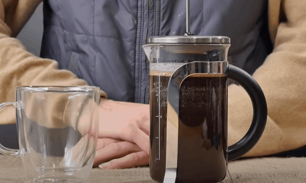 Add the coffee and water to your French press
