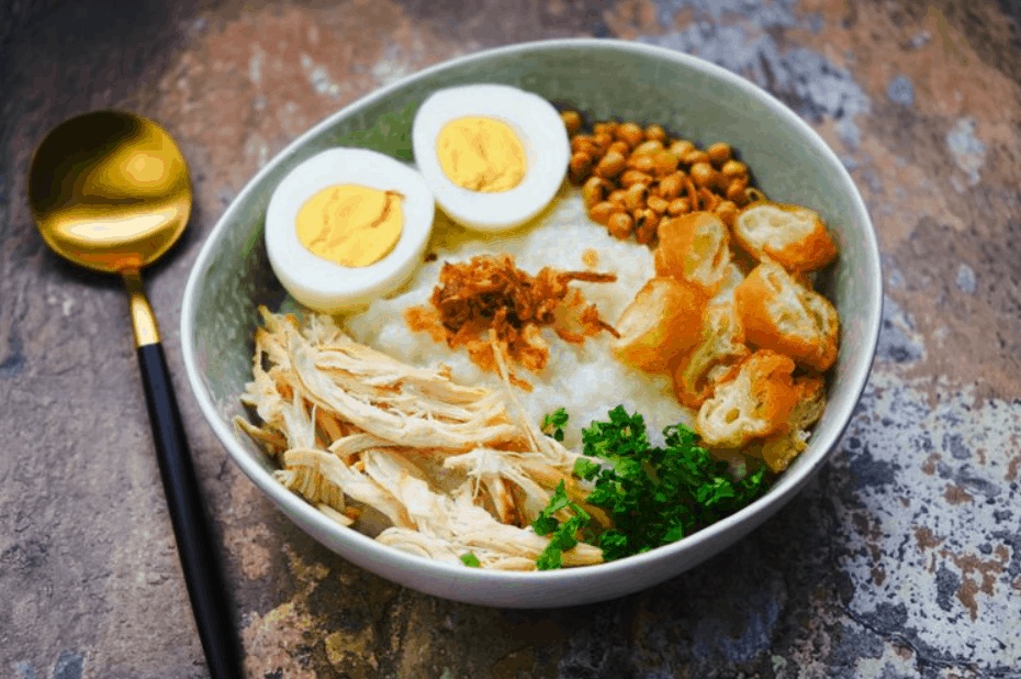 Asian Street Food Bubur Ayam, Rice Porridge with Chicken, Jakarta, Indonesia