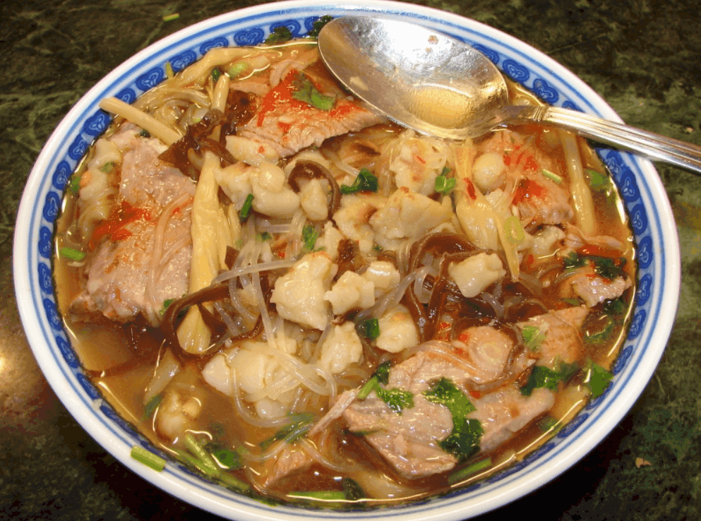 Asian Street Food Yang Rou Paomo, Lamb Soup with Pieces of Bread, Xian, China